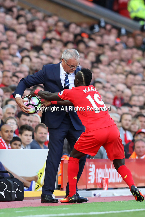 10.09.2016. Anfield, Liverpool, England. Premier League Football. Liverpool versus Leicester. Claudio Ranieri, manager of Leicester City prevents Sadio Mane of Liverpool from retrieving the ball.