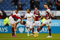 Burnley players look dejected after Burnley's Kieran Tripper scores an own goal  - Photo mandatory by-line: Matt McNulty/JMP - Mobile: 07966 386802 - 28/02/2015 - SPORT - Football - Burnley - Turf Moor - Burnley v Swansea City - Barclays Premier League