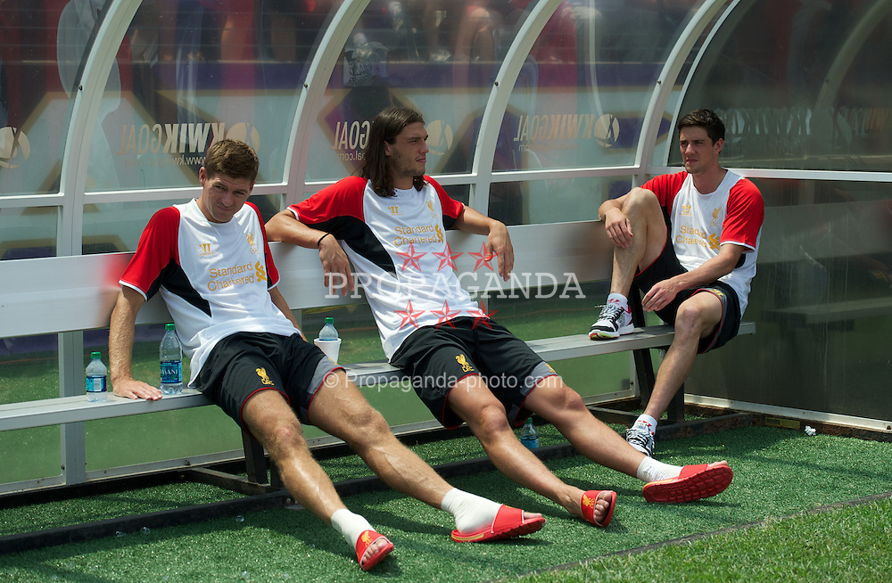 BALTIMORE, MD - Saturday, July 28, 2012: Liverpool's Andy Carroll, Jamie Carragher and Martin Kelly on the bench before a pre-season friendly match against Tottenham Hotspur at the M&T Bank Stadium. (Pic by David Rawcliffe/Propaganda)
