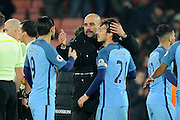 Manchester City manager Josep Guardiola celebrates the 2-0 win over Bournemouth at full time with Nolito (9) of Manchester City and David Silva (21) of Manchester City during the Premier League match between Bournemouth and Manchester City at the Vitality Stadium, Bournemouth, England on 13 February 2017. Photo by Graham Hunt.