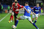 Cardiff city's Craig Noone (l) goes past Tommy Smith of Ipswich Town ®. NPower championship, Cardiff city v Ipswich Town at the Cardiff city Stadium in Cardiff, South Wales on Saturday 12th Jan 2013. pic by Andrew Orchard, Andrew Orchard sports photography,