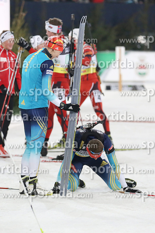 28.12.2013, Veltins Arena, Gelsenkirchen, GER, IBU Biathlon, Biathlon World Team Challenge 2013, im Bild Olena Pydrushna (Ukraine), Andriy Deryzemlya (Ukraine) enttaeuscht, upset // during the IBU Biathlon World Team Challenge 2013 at the Veltins Arena in Gelsenkirchen, Germany on 2013/12/28. EXPA Pictures &copy; 2013, PhotoCredit: EXPA/ Eibner-Pressefoto/ Schueler<br /> <br /> *****ATTENTION - OUT of GER*****
