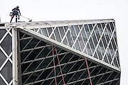 Tuesday, November 29, 2016.   Window washers (there are two, one is hidden) start the task of cleaning 9,994 exterior windows on the downtown Seattle Library designed by Rem Koolhaas, enough windows to cover 5 1/2 football fields.   <br /> <br /> Steve Ringman / The Seattle Times