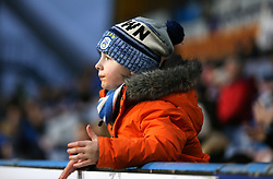 A young fan in the stand shows his support