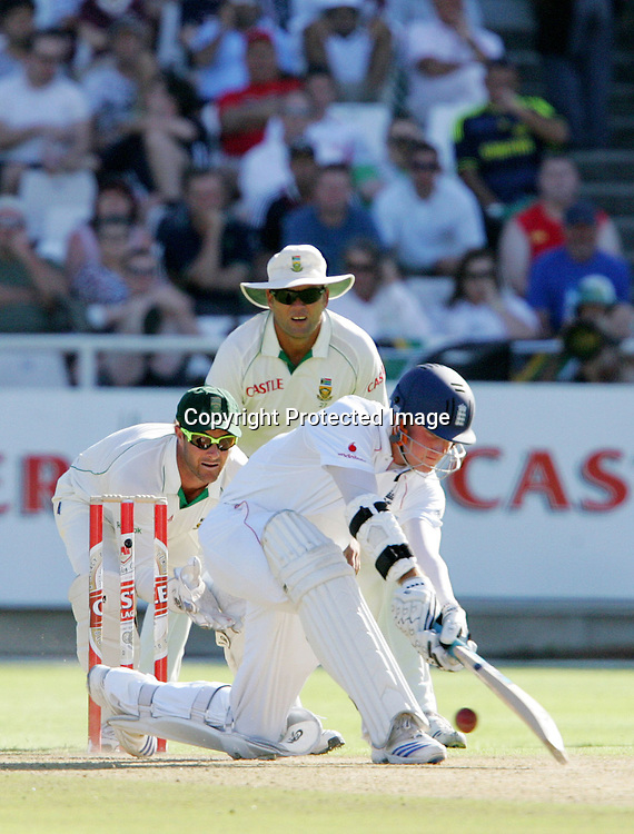 Stuart Broad reverse sweeps whilst Mark Boucher keeps wicket with Jacques Kallis at slip during the 2nd day of the third test match between South Africa and England held at Newlands Cricket Ground in Cape Town on the 4th January 2010.Photo by: Ron Gaunt/ SPORTZPICS