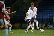 Alex Finney (Bolton Wanderers) plays the ball forward during the Pre-Season Friendly match between Bolton Wanderers and Burnley at the Macron Stadium, Bolton, England on 26 July 2016. Photo by Mark P Doherty.