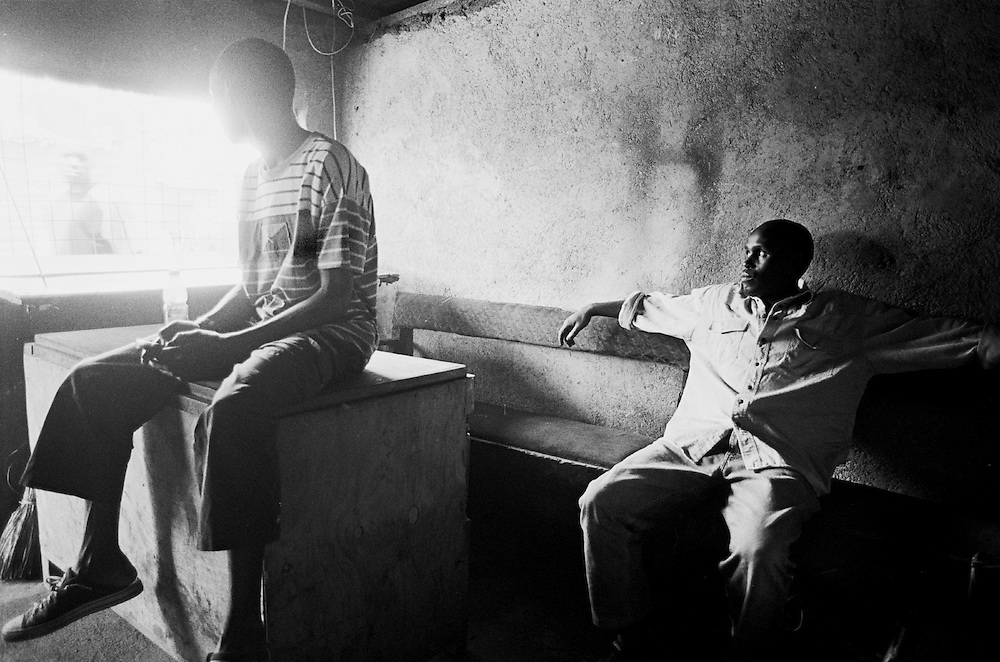Nubian youth say vetting is the primary reason why they lack documentation or National ID cards. Unemployment is a common challenge among Nubian youth because without an ID they cannot secure even basic formal employment. Two unemployed Nubian youth sit in their youth group's office in Kibera.