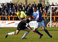 Photo: Chris Ratcliffe.<br />Barnet FC v Carlisle United. Coca Cola League 2. 25/02/2006.<br />Danny Livesey of Carlisle (R) tussles with Giuliano Grazioli of Barnet.
