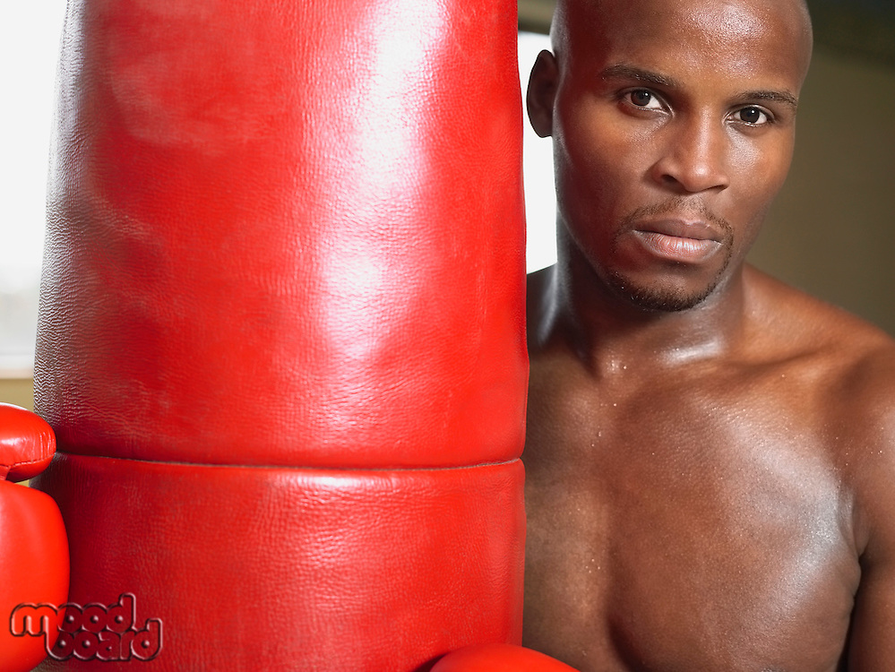 Boxer holding punching bag portrait close-up