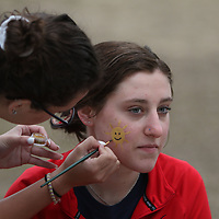 Emily Cock gets her face painted by Sophia Cuozzo Saturday morning at the CASA Superhero run in Oxford, MS
