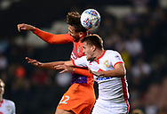 Matt Crooks of Northampton Town (l) and Scott Wootton of MK Dons battle for a header .EFL Skybet football league one match, MK Dons v Northampton Town at the Stadium MK in Milton Keynes on Tuesday 26th September 2017.<br /> pic by Bradley Collyer, Andrew Orchard sports photography.