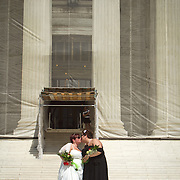 Shannon Glatz, left, and Liberty Manos, kiss to celebrate their marriage with twenty-four other couples as they traveled to Washington from Columbus Ohio, to get married en masse in front of the Supreme Court of the United States, on June 21, 2013.  John Boal photography