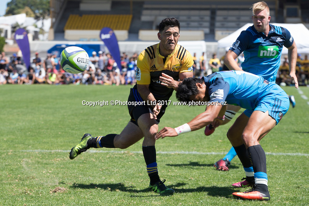 Hehe Milner-Skudder from the Hurricanes offloads as his Blues opposite Melanie Nanai makes a tackle during the preseason Super Rugby match played between the Blues and the Hurricanes at Alexandra Park, Auckland on 4th February 2017. <br /> Credit; Peter Meecham/ www.photosport.nz