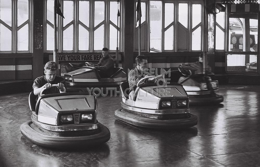 Boys on bumper cars, Brighton, UK, 1986.
