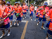 30 OCTOBER 2014 - BANGKOK, THAILAND: Traditional Thai musicians perform on Boriphat Street during the parade marking the start of the annual temple fair at Wat Saket. Wat Saket is on a man-made hill in the historic section of Bangkok. The temple has golden spire that is 260 feet high which was the highest point in Bangkok for more than 100 years. The temple construction began in the 1800s in the reign of King Rama III and was completed in the reign of King Rama IV. The annual temple fair is held on the 12th lunar month, for nine days around the November full moon. During the fair a red cloth (reminiscent of a monk's robe) is placed around the Golden Mount while the temple grounds hosts Thai traditional theatre, food stalls and traditional shows.   PHOTO BY JACK KURTZ