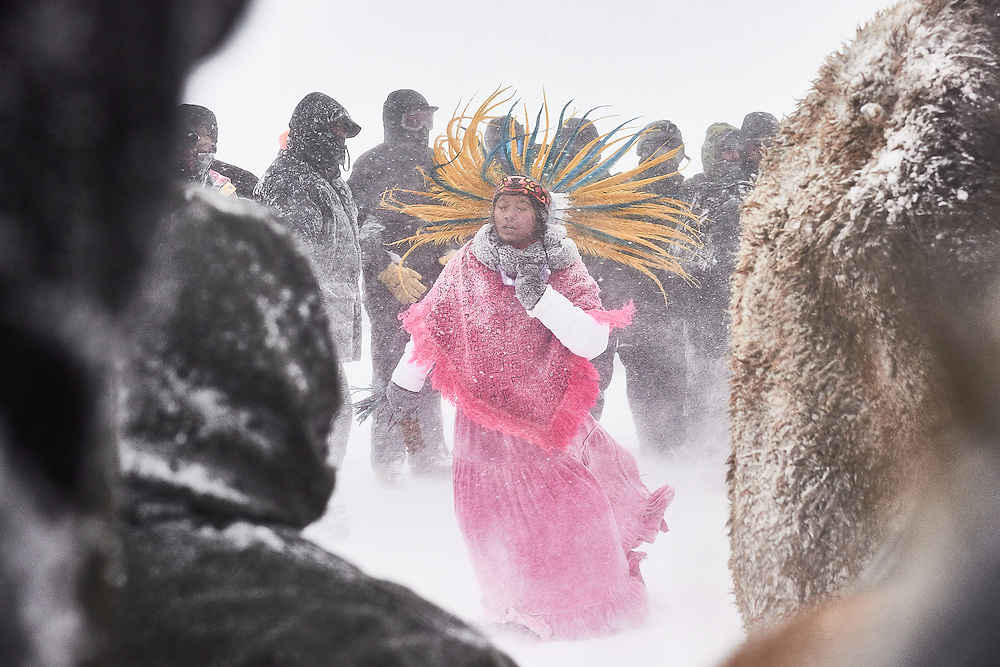 Hundreds of activists braved the coming blizzard to march out of Oceti Sakowin towards a bridge that lies a short distance from the proposed pathway of the Dakota Access Pipeline.