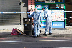 © Licensed to London News Pictures. 22/09/2016. LONDON, UK.  Forensic officers at the scene. A man was found dead in the street following a suspected assault, near All Saints DLR station just before midnight last night.  Photo credit: Vickie Flores/LNP