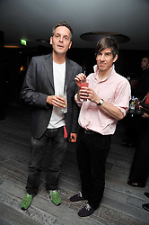 Left to right, DUNCAN CARGILL and artist GRAHAM LITTLE at a dinner in honour of artist Ryan McGinley hosted by Alison Jacques to mark the occasion of his UK debut show 'Moonmilk' held at Paramount, Level 31, Centre Point, 103 New Oxford Street, London WC1 on 10th September 2009.