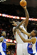 Jan 31, 2010; Cleveland, OH, USA; Cleveland Cavaliers center Shaquille O'Neal (33) gets fouled by Los Angeles Clippers forward Marcus Camby (23) during the fourth quarter at Quicken Loans Arena. The Cavaliers beat the Clippers 114-89. Mandatory Credit: Jason Miller-US PRESSWIRE