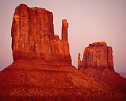 The Mitten Buttes at sunset in Monument Valley on the Navajo Indiam Reservation in northern Arizona and southern Utah