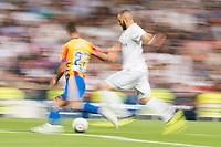 Real Madrid's Karim Benzema and Valencia's Martin Montoya during La Liga match between Real Madrid and Valencia CF at Santiago Bernabeu Stadium in Madrid, Spain August 27, 2017. (ALTERPHOTOS/Borja B.Hojas)