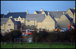 New homes being built on the outskirts of Cirencester in the Cotswolds, United Kingdom. Friday, 15th November 2013. Britain's biggest banks have warned the Chancellor that the lack of an end date to his flagship Help to Buy programme could cause serious distortion in the housing market..Picture by Andrew Parsons / i-Images
