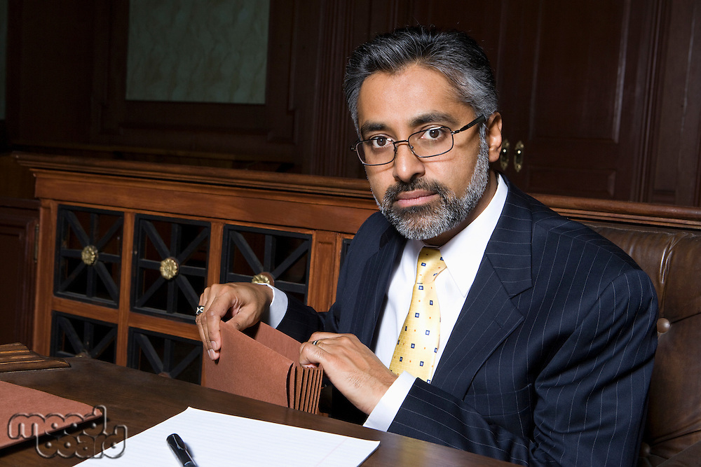 Man sitting in court, portrait