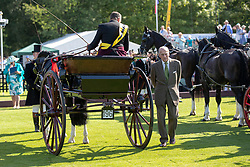 The Duke of Edinburgh presents trophies to carriage drivers during the Guards Polo Club, Windsor Great Park, Egham, Surrey.