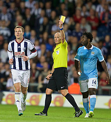 WEST BROMWICH, ENGLAND - Monday, August 10, 2015: West Bromwich Albion's Craig Gardner is shown a yellow card by referee Mike Dean against Manchester City during the Premier League match at the Hawthorns. (Pic by David Rawcliffe/Propaganda)