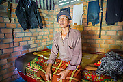 29 OCTOBER 2012 - MAYO, PATTANI, THAILAND:  Mr. PRASIT in his room at the Bukit Kong home in Mayo, Pattani. Prasit said he came to the home five years ago because he was having mental problems brought on by black magic. He said he is better now, cured by prayer and herbal medicine, but he stays to help others at the home. The home opened 27 years ago as a ponoh school, or traditional Islamic school, in the Mayo district of Pattani. Shortly after it opened, people asked the headmaster to look after individuals with mental illness. The headmaster took them in and soon the school was a home for the mentally ill. Thailand has limited mental health facilities and most are in Bangkok, more than 1,100 kilometers (650 miles) away. The founder died suddenly in 2006 and now his widow, Nuriah Jeteh, struggles to keep the home open. Facilities are crude by western standards but the people who live here have nowhere else to go. Some were brought here by family, others dropped off by the military or police. The home relies on donations and gets no official government support, although soldiers occasionally drop off food. Now there are only six patients, three of whom are kept chained in their rooms.  Jeteh says she relies on traditional Muslim prayers, holy water and herbal medicines to treat the residents. Western style drugs are not available and they don't have a medic on staff.    PHOTO BY JACK KURTZ