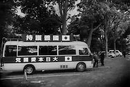 """Mini-van fitted with loudspeakers by a Nationalist Organization parked at Yasukuni War Shrine.  Vans like this can be seen plying the streets of central Tokyo blaring martial music and a voice over rostering off the """"du jour"""" bogey man, be it, North Korea, China or the United States military depends on current events."""