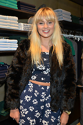 SASHA KEABLE at a party to celebrate the reopening of the Lacoste Premium Store at 233 Regent Street, London on 28th May 2014.
