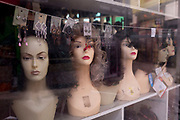 As the second week of the Coronavirus lockdown continues around the capital, and the UK death toll rising by 563 to 2,325, with 800,000 reported cases of Covid-19 worldwide, in accordance with the government's forced lockdown and closure of businesses, mannequin heads in the window of a small local businesses in Brixton Village market, on 31st March 2020, in London, England.