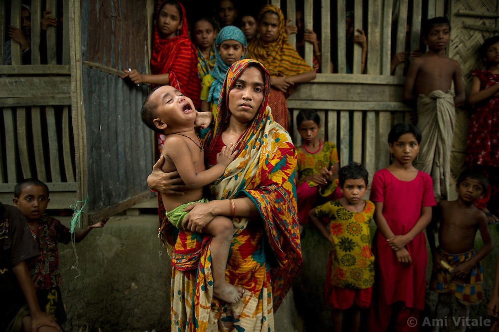 """Women   from the fishing village of Dema in Barguna Sadar upazila  in Bangladesh gather to console one another after it was learned that a boat carrying their loved ones capsized,  October 19, 2010 . Because of climate change, the seas are getting more violent, less predictable and boats are capsizing more frequently. Twenty percent of the women in this village are widows because so many have lost their husbands in the seas. Coastal and fishing populations are particularly vulnerable and Fishing communities in Bangladesh are subject not only to sea-level rise, but also flooding and increased typhoons. Erosion as a result of stronger and higher tides, cyclones and storm surges is eating away Bangladesh's southern coast.  Yet the largely fishing community cannot live without the sea. """"We only know how to catch fish,"""" say the fishermen. ( Ami Vitale)"""
