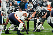 Derek Carr (QB) of the Oakland Raiders  takes the snap during the International Series match between Oakland Raiders and Chicago Bears at Tottenham Hotspur Stadium, London, United Kingdom on 6 October 2019.