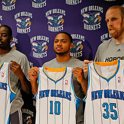 December 17, 2011; New Orleans, LA, USA; New Orleans Hornets small forward Al-Farouq Aminu (3), guard Eric Gordon (10) and center Chris Kaman (35) at a press conference to introduce players acquired from the Los Angeles Clippers in the Chris Paul trade prior to team scrimmage at the New Orleans Arena.   Mandatory Credit: Derick E. Hingle-US PRESSWIRE