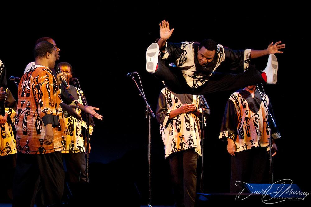 Ladysmith Black Mambazo member Thulani Shabalala leaps into the air at The Music Hall, Portsmouth, NH