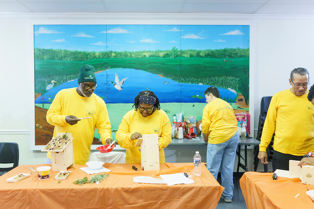 Upper Marlboro, Maryland - January 03, 2017: Members of the Senior Green Team (L-R) Arthur Harris, Carolyn Harris, Carole Redman (back table), and C.P. Payne build and decorate birdhouses at the Watkins Park Nature Center in Upper Marlboro, Md., Tuesday January 3, 2017. The group meets the first Tuesday morning of each month and works on nature beautification projects like trail maintenance, tree planting, clean ups, and, educational outings. <br /> <br /> CREDIT: Matt Roth