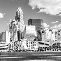 Charlotte skyline panorama black and white image. Includes Romare Bearden Park, cloudy sky, One Wells Fargo Center, Two Wells Fargo Center, Bank of America Corporate Center, Bank of America Plaza, 121 West Trade building, and Carillon Tower. Charlotte, North Carolina is a major city in the Eastern United States of America