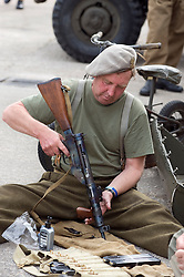 A reenactor portraying a member of the 1st (Polish) Independent Parachute Brigade cleans a personal weapon at the Elsecar 1940s Weekend <br />