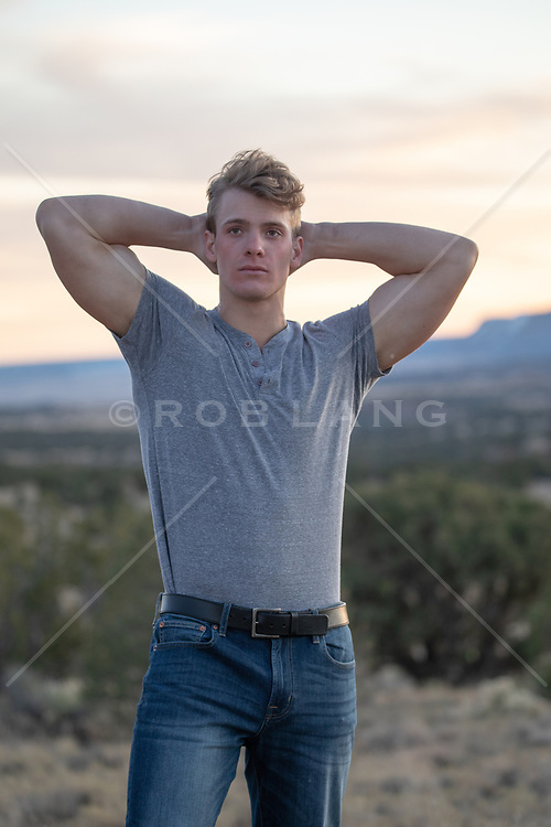 chiseled All American man with great arms outdoors