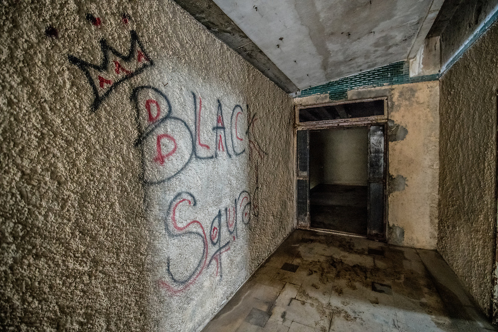 Graffiti spray painted on the interior of the abandoned Ducor Hotel, once the most prominent hotels in Monrovia, Liberia