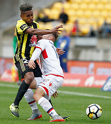 Adelaide United's Benjamin Garuccio, right, runs into the arm of the Phoenix's Roy Krishna in the A-League football match at Westpac Stadium, Wellington, New Zealand, Sunday, October 08, 2017. Credit:SNPA / Dean Pemberton **NO ARCHIVING**