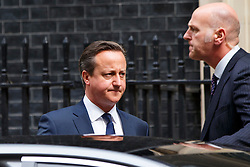 © Licensed to London News Pictures. 08/07/2015. Westminster, UK. Prime Minister David Cameron leaving Downing Street before Chancellor of the Exchequer George Osborne presents his summer budget to Parliament on July 8, 2015. Photo credit: Tolga Akmen/LNP