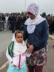 October 24, 2016 - Calais, Northern France, France - Image ¬©Licensed to i-Images Picture Agency. 24/10/2016. Calais, France. Calais Jungle Eviction. A woman and child arrive to be processed and then bussed out out to reception centres across France. It is estimated that 3000 refugees and migrants to be processed. Picture by Pete Maclaine / i-Images (Credit Image: © Pete Maclaine/i-Images via ZUMA Wire)