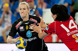 Tine Kristiansen of Larvik vs Ljudmila Bodnieva of Krim during handball match between RK Krim Mercator and Larvik HK (NOR) of Women's EHF Champions League 2011/2012, on November 13, 2011 in Arena Stozice, Ljubljana, Slovenia. (Photo By Vid Ponikvar / Sportida.com)