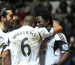 Swansea City's Wilfried Bony celebrates with Swansea City's Ashley Williams - Photo mandatory by-line: Alex James/JMP - Tel: Mobile: 07966 386802 08/02/2014 - SPORT - FOOTBALL - Swansea - Liberty Stadium - Swansea City v Cardiff City - Barclays Premier League