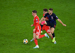 CARDIFF, WALES - Sunday, October 13, 2019: Wales' Harry Wilson (L) and Daniel James (C) are challenged by Croatia's Nikola Vlašić during the UEFA Euro 2020 Qualifying Group E match between Wales and Croatia at the Cardiff City Stadium. (Pic by Paul Greenwood/Propaganda)