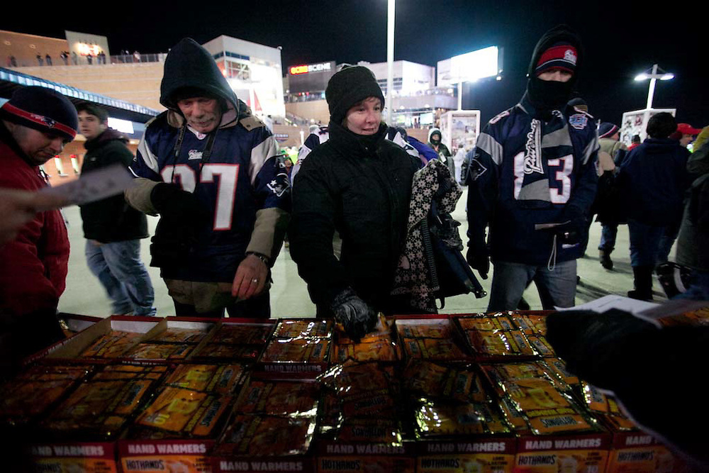 Foxborough, MA 01/14/2012.Patriots fans pick up some of 20,000 free handwarmers given out before the start of Saturday's AFC Divisional game between the Patriots and the Denver Broncos..Wicked Local Photo by Alex Jones