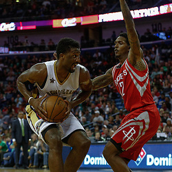 Mar 17, 2017; New Orleans, LA, USA; New Orleans Pelicans forward Solomon Hill (44) is guarded by Houston Rockets guard Lou Williams (12) during the second half of a game at the Smoothie King Center. The Pelicans defeated the Rockets 128-112.  Mandatory Credit: Derick E. Hingle-USA TODAY Sports
